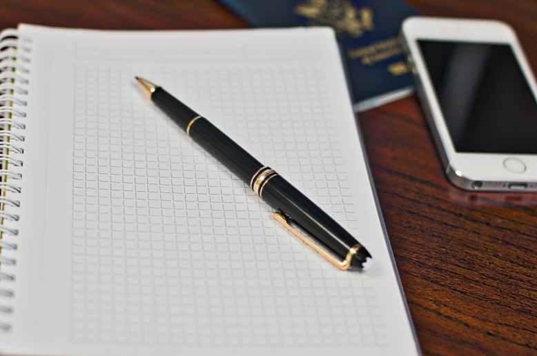 black click pen on spring notebook